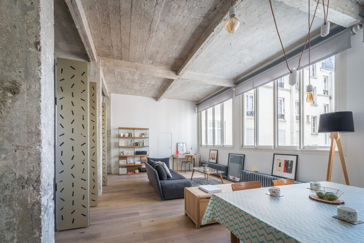 Completed in 2017 in Paris, France. Images by Alexandre Delaunay. The apartment is located in a 1920's industrial building of Paris' 11th arrondissement. The initial space of square proportions is stripped down to...