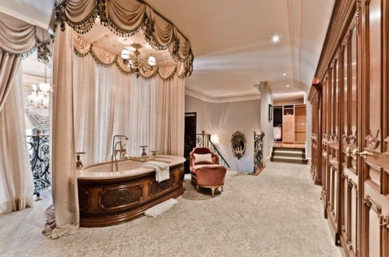 Celine Dion's is selling her Canadian mansion for $29.3 million--the master bath is carpeted, with a canopy over the tub.