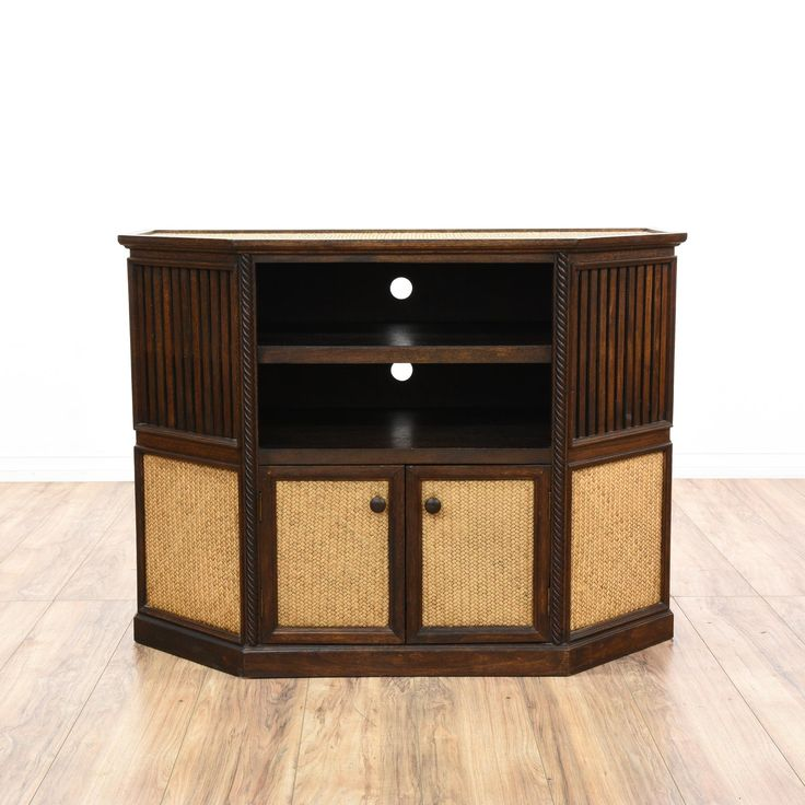 This media stand is featured in a solid wood with a glossy rosewood finish. This Asian-style TV cabinet has woven panels, bottom cabinet with ample storage space, and 2 shelves. Perfect for storing DVDs! #asian #storage #mediacenter #sandiegovintage #vintagefurniture