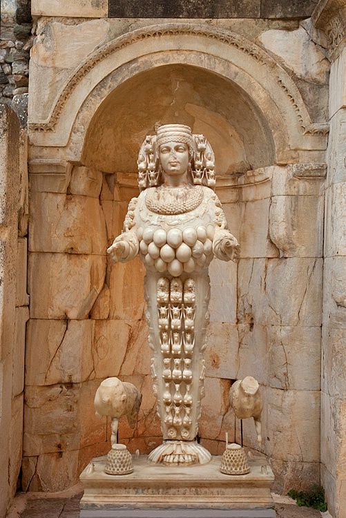 A second-century statue of the Greek goddess Artemis (the Roman Diana), in the ruins of Ephesus, Turkey; the objects decorating her body have been interpreted as bulls' testicles or breasts, both symbols of fertility.