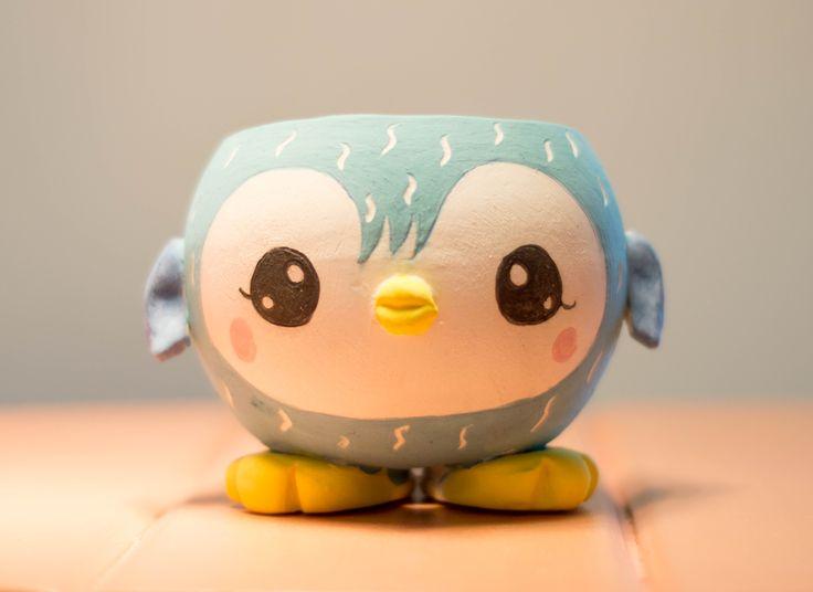 Maceta de cerámica pingüino.