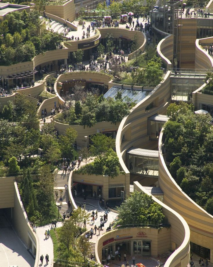 Pockets of organically layered green space by a skyscraper ...