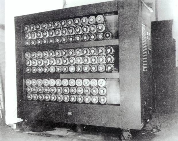 Front of a 'bombe' code-breaking machine at Bletchley Park, 1943. The electromagnetic machines were used to determine the plugboard settings of German Engima machines. This involved multiple 'bombes', piles of perforated papers and production lines of analysts to interpret the results.