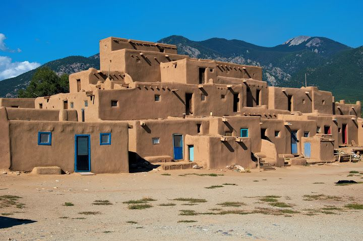 Taos Pueblo, New Mexico. Taos Pueblo is the only living Native American community designated both a World Heritage Site by UNESCO and a National Historic Landmark.  The multi-storied Taos Pueblo adobe buildings have been continuously inhabited for over 1000 years. It is the longest continuously inhabited place in the entire country. Photo by Andy New.