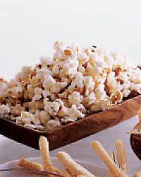 Truffled Popcorn - I use the Ina Garten recipe from How Easy is That. One bag Newmans Natural microwaved popcorn and 2oz white truffle butter (avail gourmet grocers, i find it at Treasure Island in CHI) plus 1ts Kosher salt. Seriously, how easy is that!