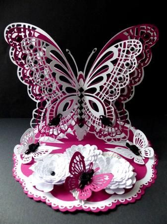 3D Standing Butterfly CraftROBO Cameo on Craftsuprint designed by Tina Fitch - made by Marion Enefer - Beautiful butterfly card by Tina . Used 250gsm white card and 160gsm deep pink card to cut out all the elements on my Cameo.Assembled the base and butterfly as required and then decorated with jet black gems and satin rose buds on the butterfly wings and flowers. Absolutely stunning when completed. - Now available for download!