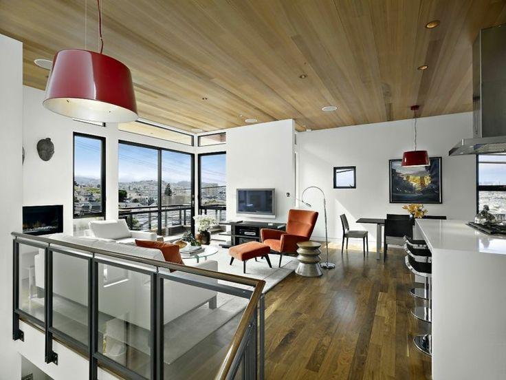 diseño de salon moderno con techo de madera