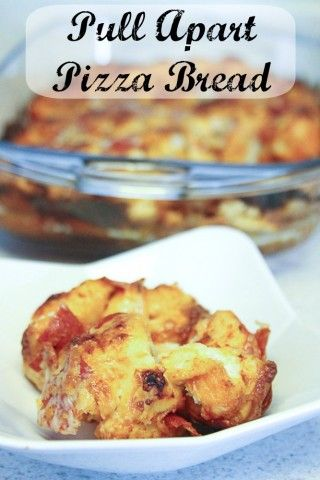 Love how she made pizza into a pull apart bread that is perfect for a party! #partyfood #recipes #pizza  justusfourblog.com