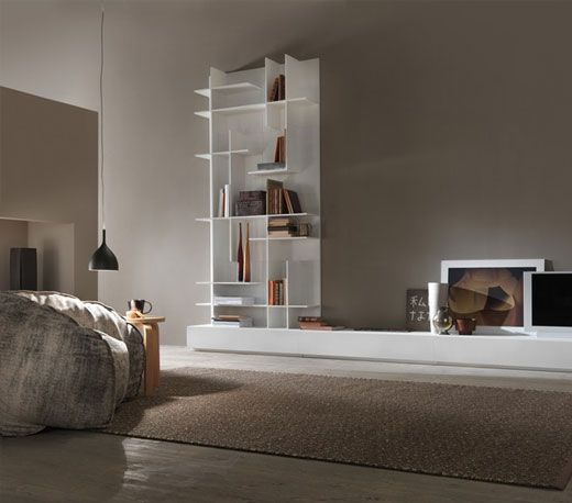 """Asymmetrical """"randomly"""" placed shelves dissect the rectangular shape of the unit making it look less harsh."""