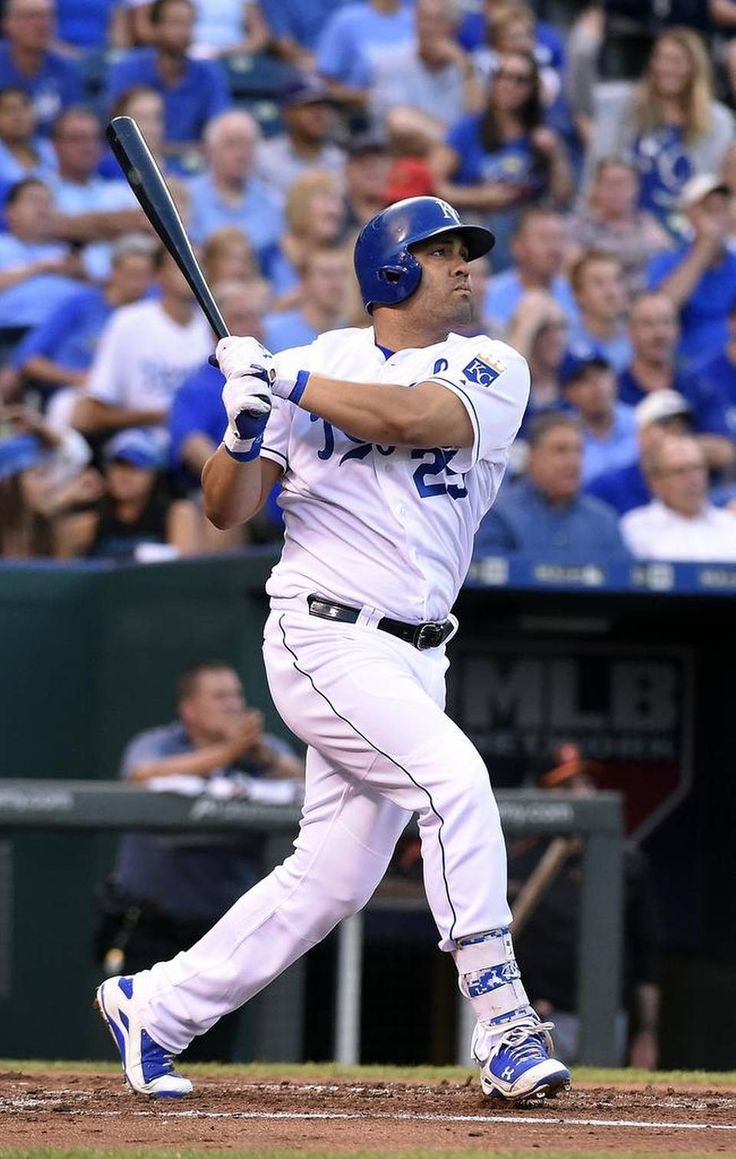 Kansas City Royals designated hitter Kendrys Morales (25) watches his solo home run in the second inning during Tuesday's baseball game against the Baltimore Orioles on August 25, 2015 at Kauffman Stadium in Kansas City, Mo.