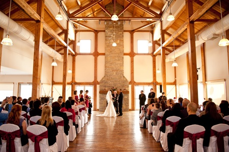 Love the exposed wooden beams, old floor, and tall fireplace... {at Grey Silo Golf Course ...