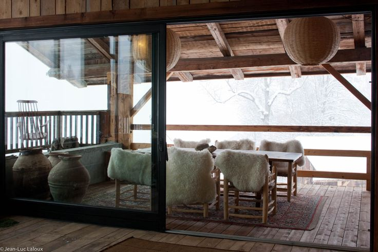 Large sliding doors lead onto this ski retreat patio #interiordesign #design #interiors #bespoke #homes #designer