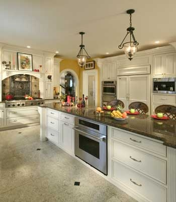 Have space for a 20 foot granite-topped island?  This luxurious home has all the ammenities: hearth alcove for the  professional-grade stainless steel Thermador cooktop, dual dishwashers (one in the island), double wall ovens and built-in coffee center. Yellow walls set off the French Country Antique White cabinetry.  Arched valance over the range echos the arched doorway nearby.