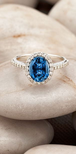 Love this halo engagement ring featuring a dazzling and unique sapphire.