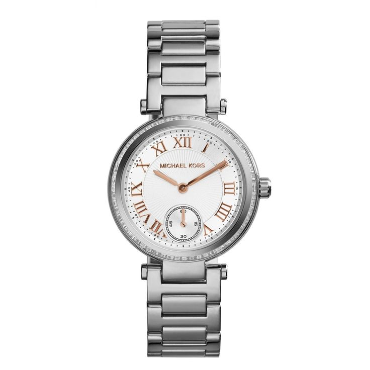 This women's stainless steel timepiece by Michael Kors features a classic white dial with elegant rose goldtone Roman numeral markers and a convenient subdial. Finished by a stone accented silvertone bezel and matching bracelet.