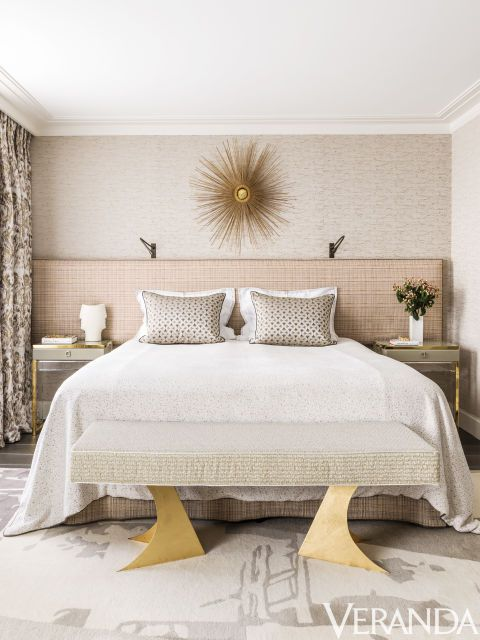 Texture and pattern animate a monochromatic scheme in this townhouse in Belgravia. The bed linens are by Nobilis and Pasaya, the pillows are in an Osborne & Little fabric and the custom bench is in a Dedar fabric. The mirror is vintage.