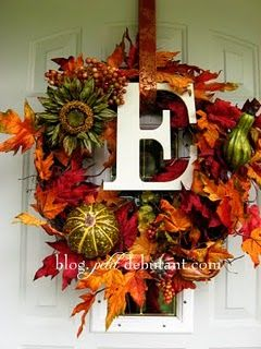love the letter in the center- I have a wreath similar to this.  I see a trip to Hobby Lobby in my future for the letter!