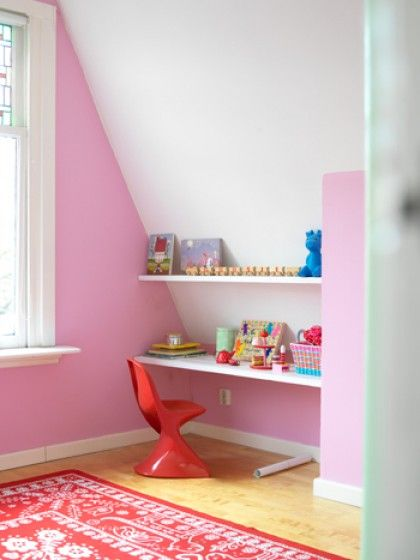 Soft pink on the walls and a useful working area with sloping walls