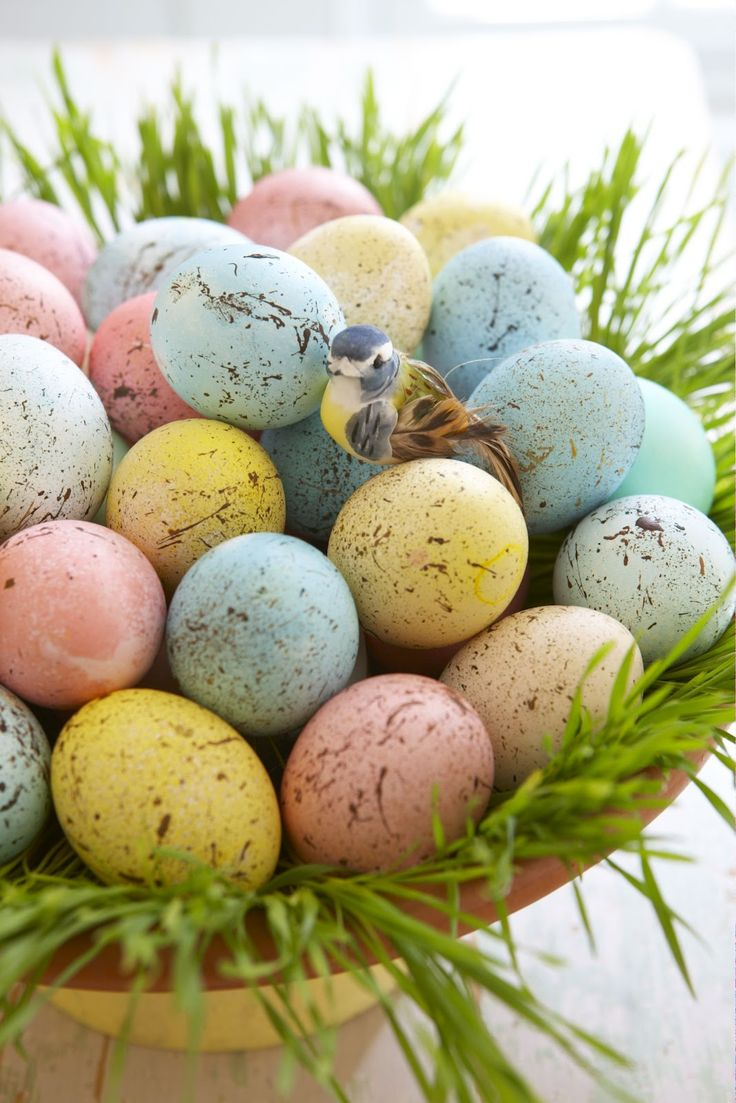Speckled eggs melt my heart!  Dye eggs soft pastel colors. Dry. Use watered-down sepai brown acrylic paint, take an old toothbrush and run your finger along the brush to splatter paint. Use cardboard behind eggs to contain splatters. Ring of wheat grass around edge of dish for display.