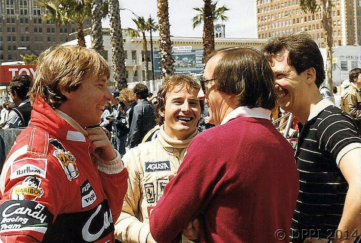 Didier Pironi, Gilles Villeneuve Speaking with Jackie Stewart. USGP 1982 Long Beach. This was two weeks before the betrayal at Imola. Gilles & Didier had always gotten along until then.