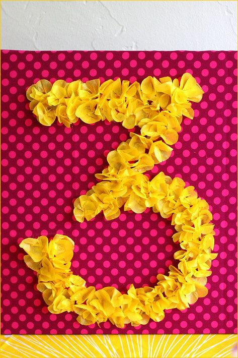 DIY Number Sign with tissue paper for Birthday party decor and pictures.