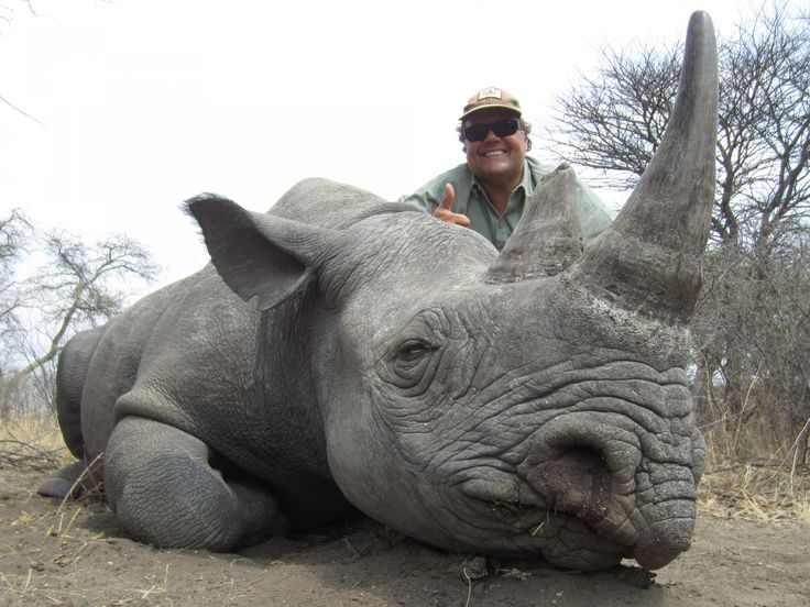 """A Reason Not to Eat Jimmy Johns - Jimmy John Liautaud with his """"trophy."""" A extremely endangered Black Rhino."""