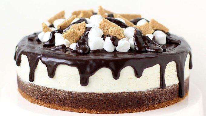 Brownie S'mores Cheesecake.... Layers of decadent chocolate brownie, marshmallow cheesecake fluff, and chocolate ganache are topped with marshmallows and graham crackers.
