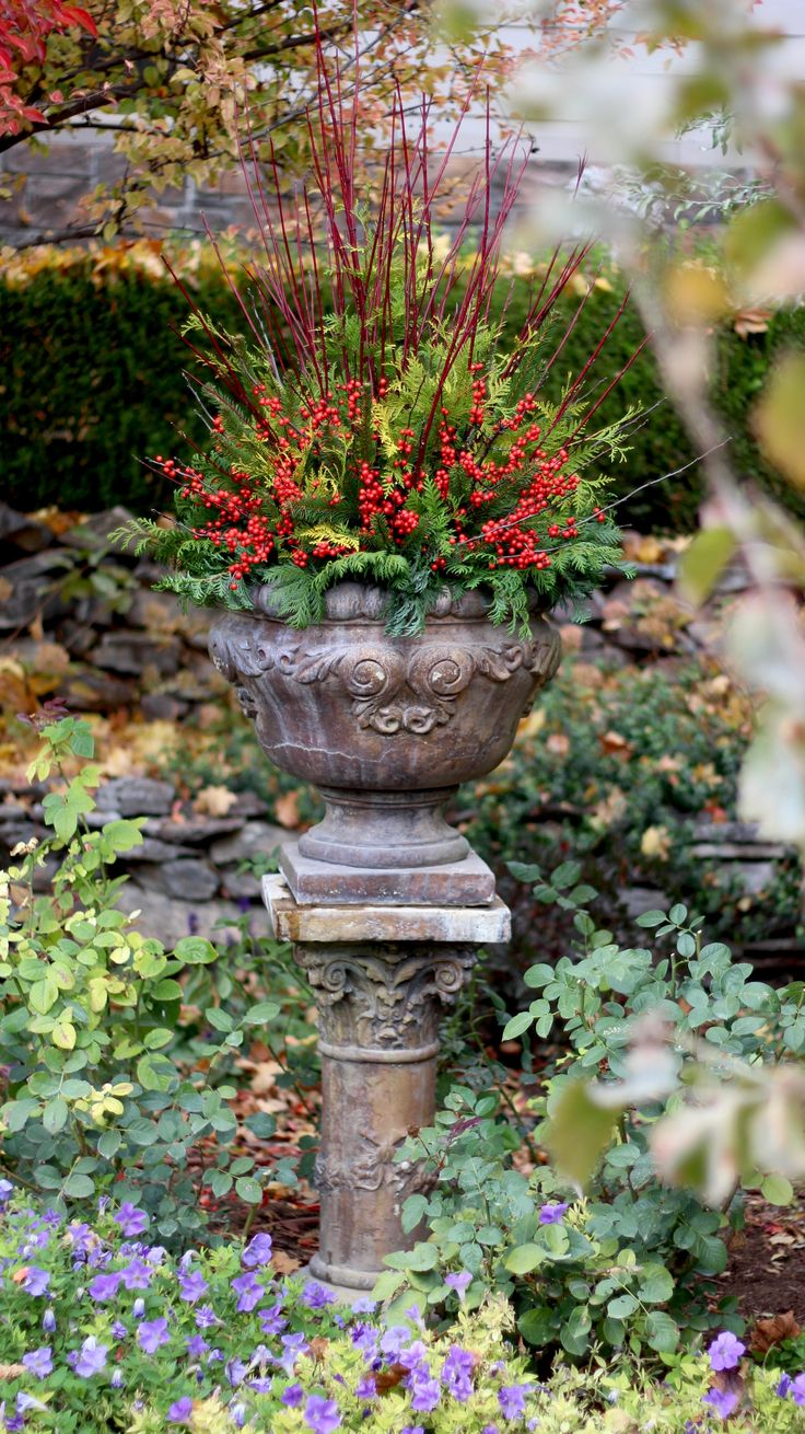 Container gardening can happen in the winter months too! This great design uses simple garden elements to make a long-lasting winter urn.