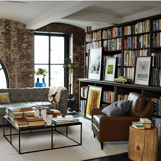 dark paint and bright windows make this cozy nook library very inviting