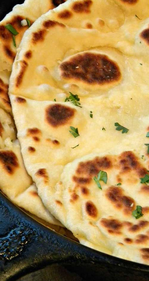 Recipe for Garlic-Butter Naan - The aroma of fresh cooking garlic naan slathered in warm garlic-butter is mouth-watering! Perfect for garlic lovers and Indian Cuisine Fanatics!