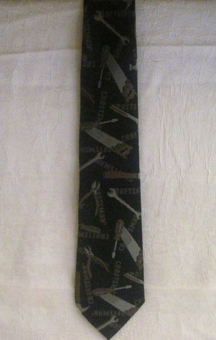 Ralph Marlin Craftsman Tie Necktie Gray Tool Print 100 percent Polyester Print in colors Charcoal Gray, Silver, and Brown. 56 inches in length 3.75 inches at it's widest point. Silk Tie in a novelty print featuring Craftsman Tools (Sears), slight sheen evident when tie moves in the light..