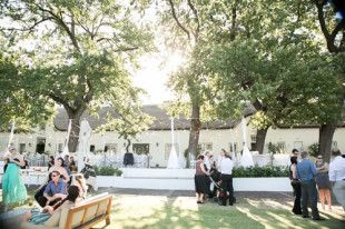Outside wedding, grey, white and black ribbon, pink, white and green flowers. Outside wedding. Laborie wine estate, Paarl South Africa.