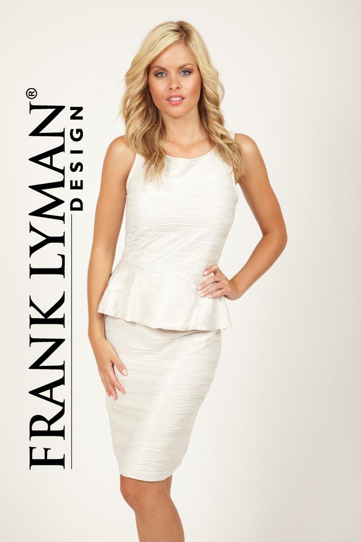 Pearl coloured peplum dress.  Classy and beautiful.  www.sofias-boutique.com