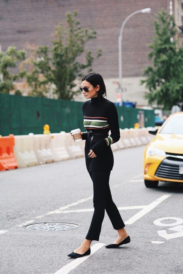 Danielle Bernstein of We Wore What wears a striped turtleneck, belt, cropped pants, ballet flats, and aviator sunglasses