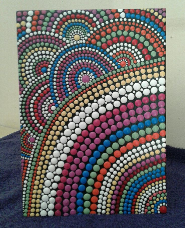 Dot art painted on a canvas board