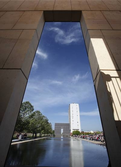 Looking west through the Gates of Time down the Reflecting Pool. An estimated crowd of 2,000 attended the Remembrance Ceremony to mark the 17th anniversary of the 1995 bombing of the Alfred P. Murrah Federal Building in downtown Oklahoma City in which 168 people were killed. Photo taken April 19, 2012. Photo by Jim Beckel, The Oklahoman