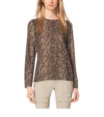 Channel the season's sophisticated safari mood in this long-sleeved top. Designed in a wrinkle-free fabric and finished with subtle embellishments, this python-printed piece is surprisingly versatile. Pair it with slim-fit cargo pants for a tame, tasteful take on the trend.