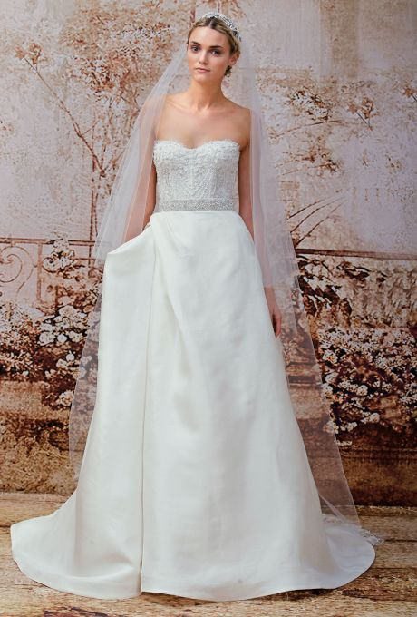 Brides.com: Monique Lhuillier - Fall 2014. Strapless A-line wedding dress with structured beaded sweetheart bodice and draped satin skirt, Monique Lhuillier