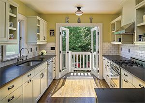 Slideshow of 9 Clever Kitchen Ideas. I would paint a different color. Love the doors on the end to deck area.