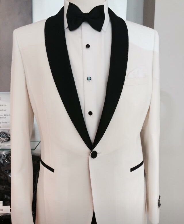 Peppers formal wear. Slim fit. Ivory tuxedo jacket. Black lapel. Made to measure. Australian wool. Peppers Formal Wear, suits hire and sales. Men's wedding fashion.