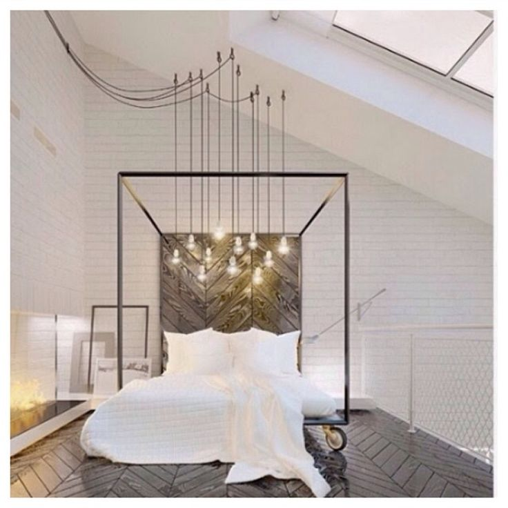 How handy - a bed on wheels. And I love the bare bulbs hanging from the roof. Like stars in the night sky. I wish I had a bedroom loft...
