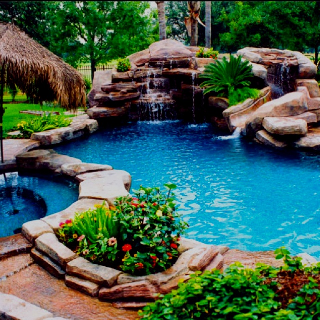 Awesome pool with a water slide | Natural Pools ...