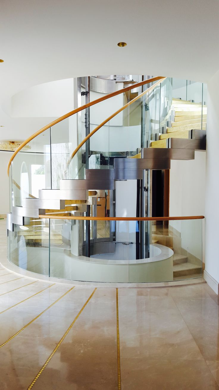 This amazing helical staircase was built for a luxury Villa in Tunis. The strings are in stainless steel and the treads are in gold leave. Together with the curved glass railing this is really a unique. www.stairs-siller.com