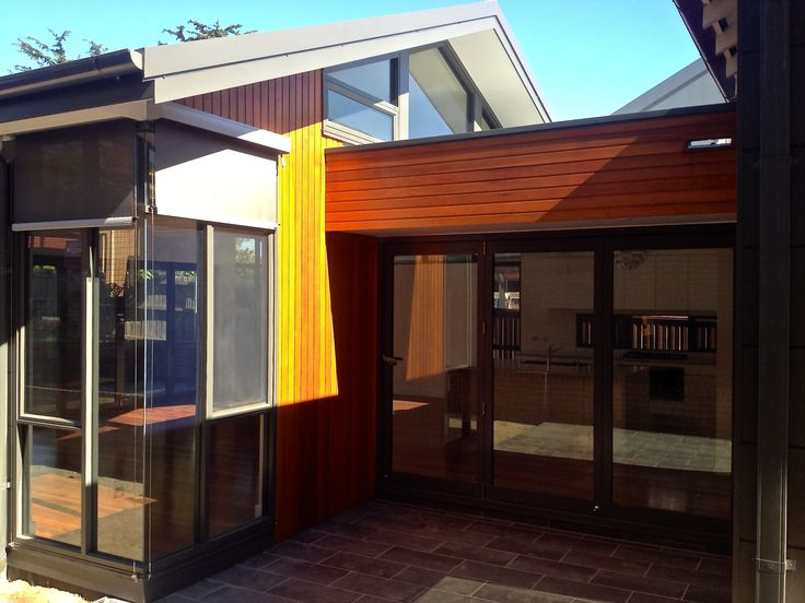 #parkshuttersandblinds #Luxaflex #Evo cable guide awning's protect this modern home from the glare and heat. The fabric rolls up into its own individual head box.