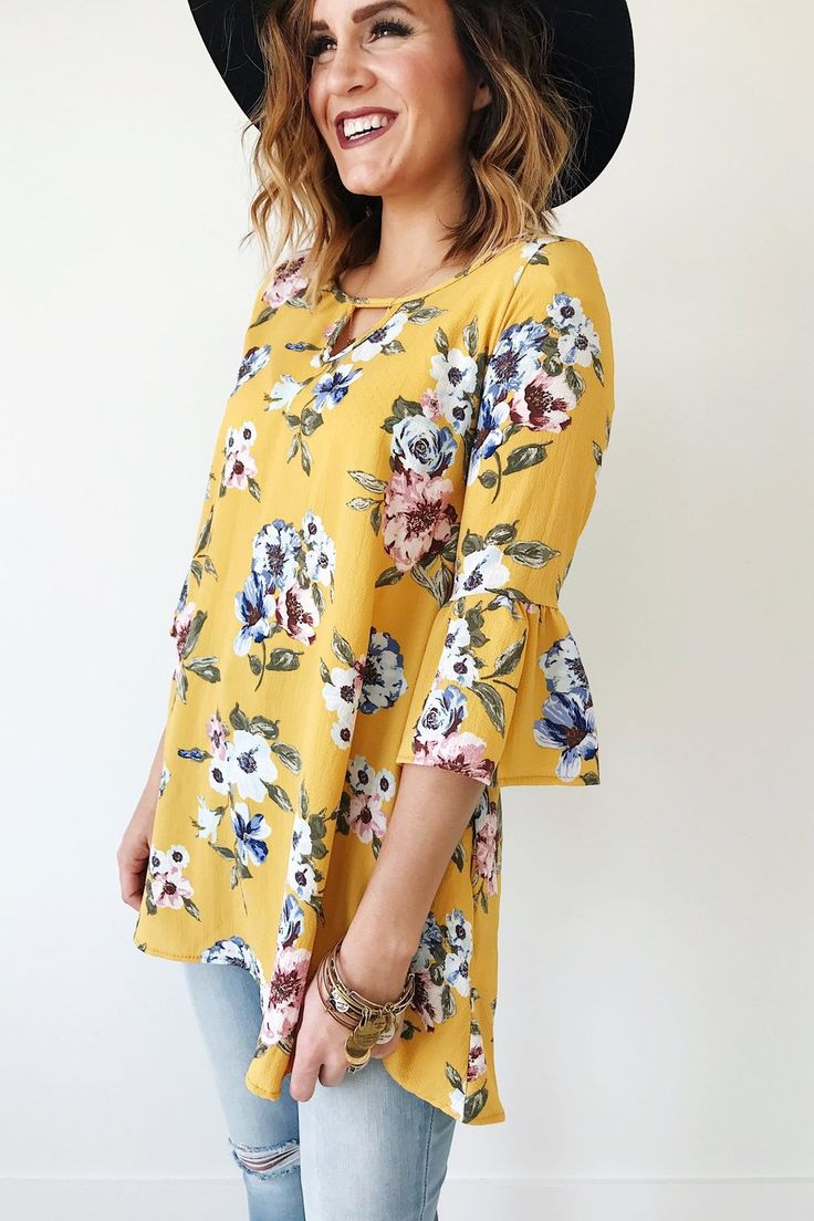 Canary Hi-Lo Blouse  Floral Print  Almond Keyhole Neckline  3/4 Bell Sleeve  Loose Fit  Also Available in Periwinkle