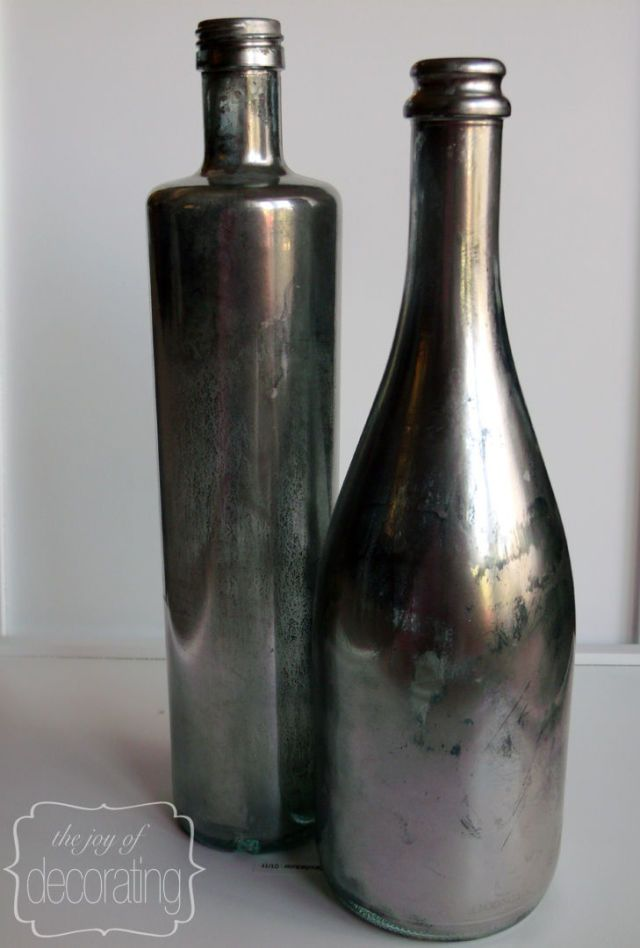 These metallic bottles will add a chic touch to any room. Group them together for an even bigger statement piece.  Get the tutorial at The Joy of Decorating.    - CountryLiving.com