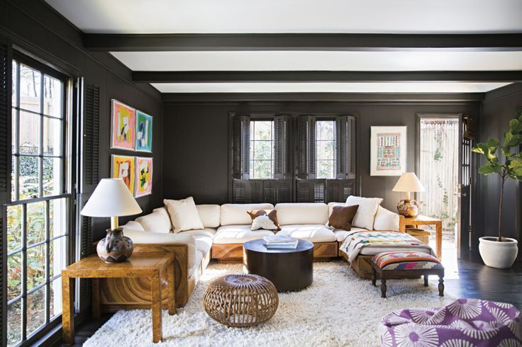 black walls, light sofa