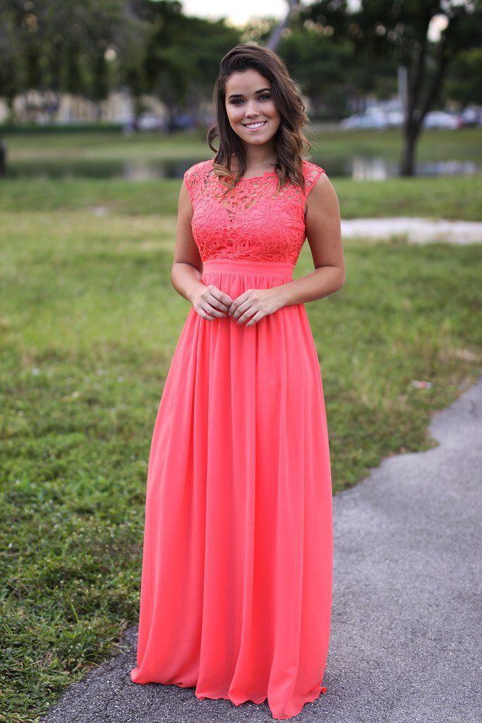Gorg NEW color! Our Coral Crochet Maxi Dress with Tulle Back has just arrived! It is the perfect gown for a special occasion and perfect for bridesmaid dresses! Measurements: Size Bust Waist Length S