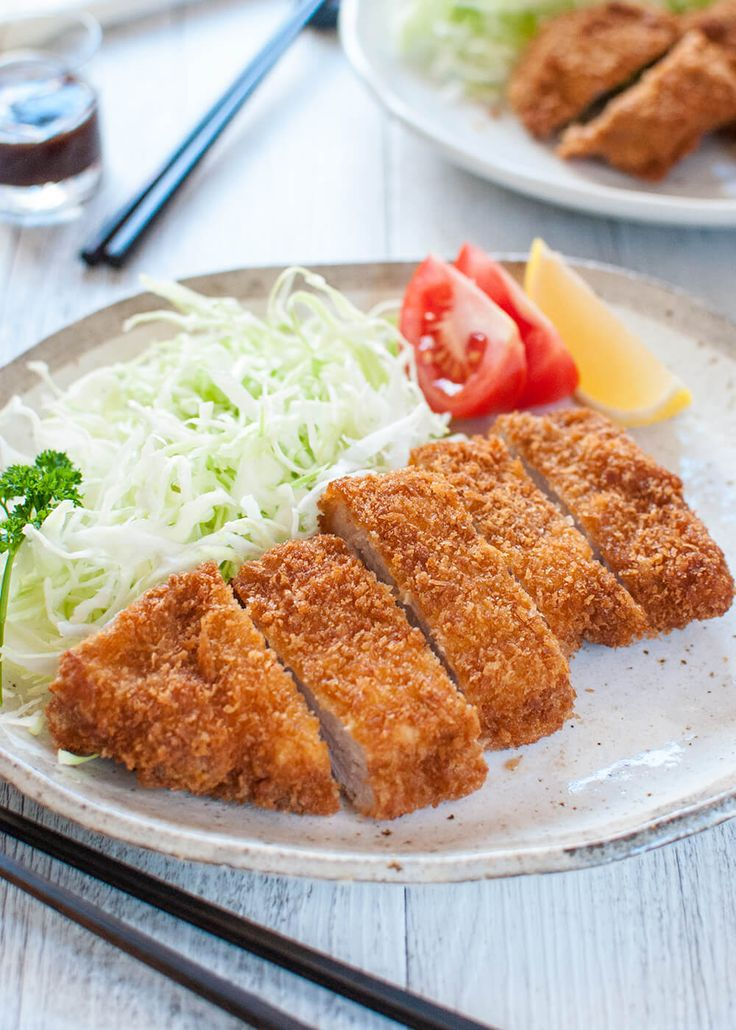 Breaded, deep fried crispy pork cutlet, Tonkatsu (Japanese Pork Schnitzel) is quite easy to make and served with sweet and spicy sauce.