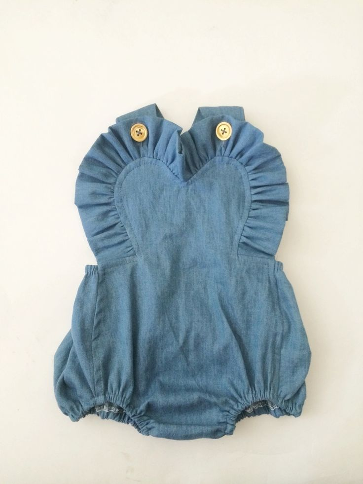 light and soft chambray. adjustable straps with vintage gold buttons. elastic at back. ruffle-less bum.hand wash only. cold water. hang to dry. see size chart for sizing.please allow 3-4 weeks construction time for your made to order piece. before purchasing, PLEASE READ SHOP POLICIES. ALL SALES FINAL.